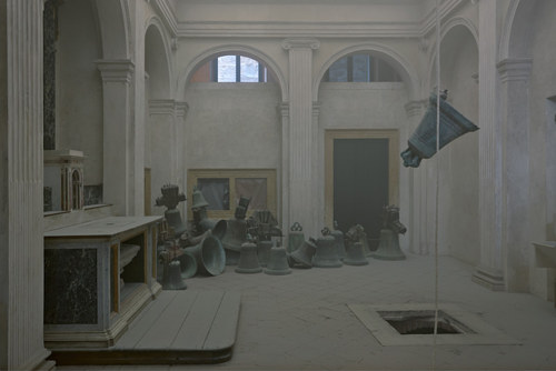 An installation consisting of ornate bells and a room filled with soot