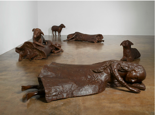 A bronze cast installation of sculptures of 3 women and 3 sheep