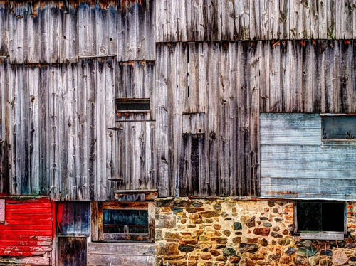 A photo of the side of a textured wood barn