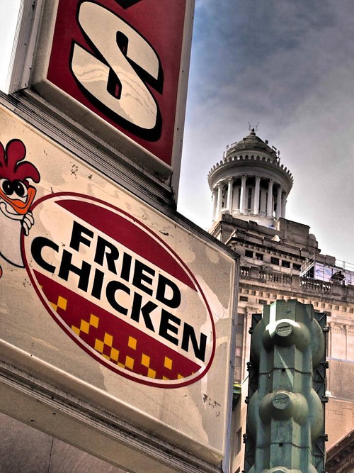 A photo of a sign in front of a fried chicken restaurant