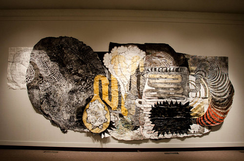 A large wall hanging made from paper mache and a variety of natural pigments