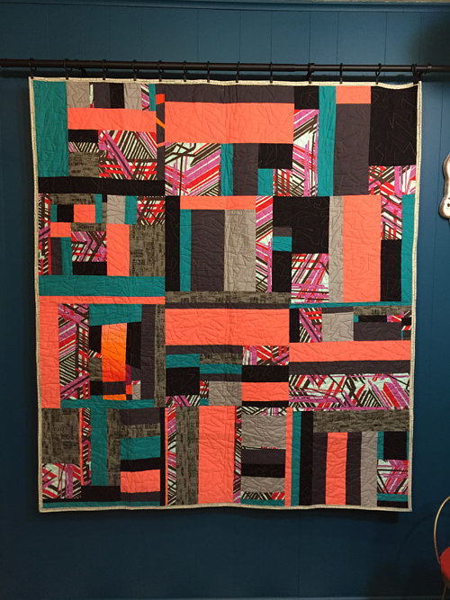A quilt made from long rectangular pieces of fabric