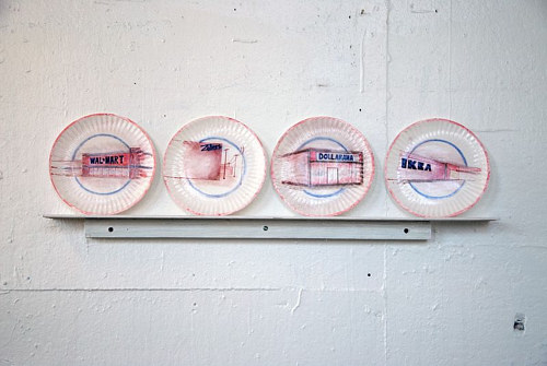 A collection of paper plates with drawings and seriagraph prints on them