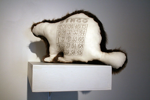 A plush sculpture made to look like a beaver with a Bingo card printed on it