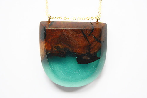 A jewelry pendant from handmade resin and Australian wood