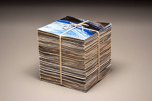 stack of photographs wrapped with a string
