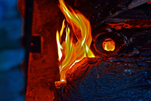 A manipulated photo of a flame emerging from a structure