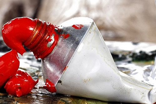 A photo of a tube of Cadmium red paint