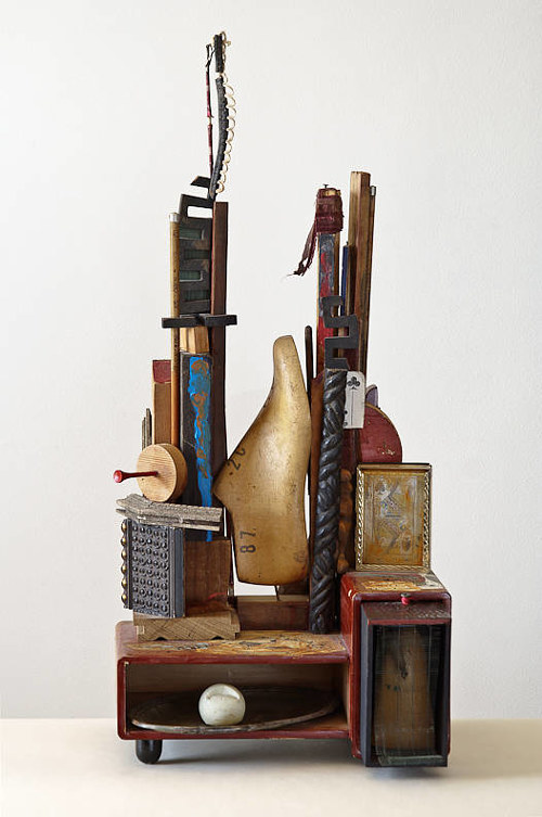 A photo of an assemblage artwork made from various objects