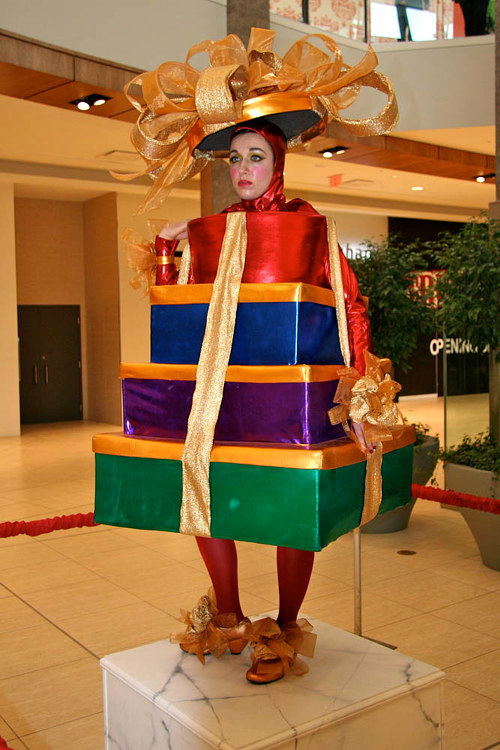 A photo of a woman wearing a costume made to look like presents