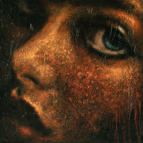 A close-up portrait of a young woman on textured board