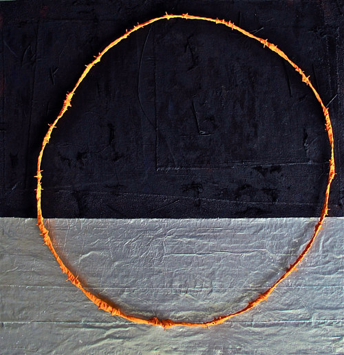 A mixed media artwork with a raised circle of wrapped barbed wire