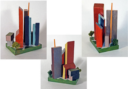 A painted assemblage made from wood and model trees