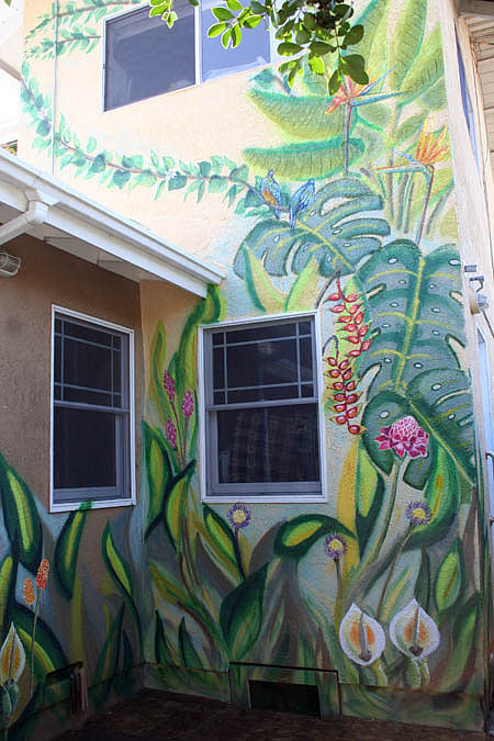 A corner mural in an outdoor garden
