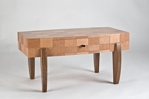 A coffee table made from a checkered design of different wood pieces