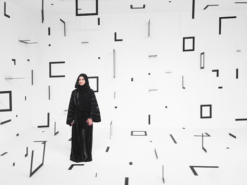 An installation with black squares hung throughout the gallery space