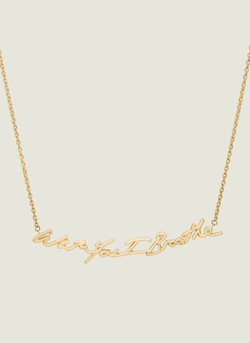 A photo of a new gold necklace from Tracey Emin and Stephen Webster
