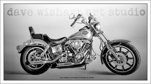 A realistic black and white drawing of a motorcycle
