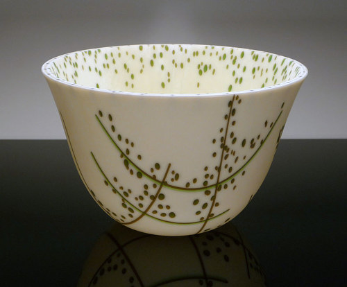 A kilnformed glass bowl with a minimal pattern on the outside