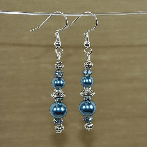 A pair of blue and silver drop earrings