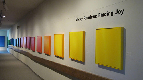 A photo of a series of monochrome paintings installed in a gallery