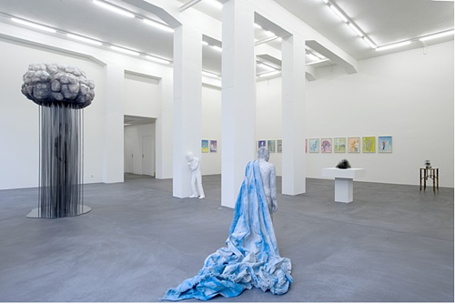An installation view of a sculpture of a raincloud