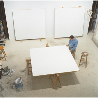 A photo of Robert Ryman at work in his studio