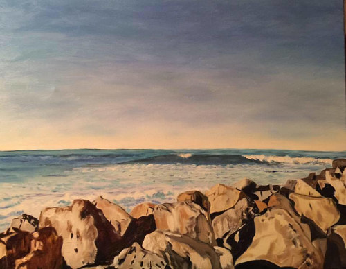 A painting of an outcropping of rocks on the shore