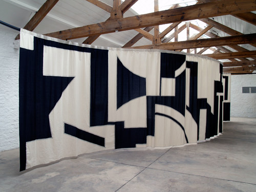 A large cotton room divider with geometric shapes