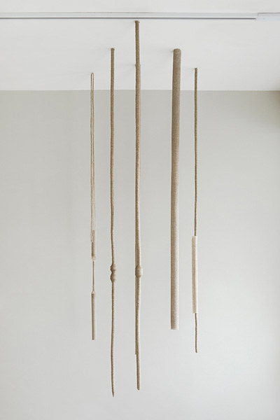 A sculpture of linen and thread ropes hanging from the ceiling