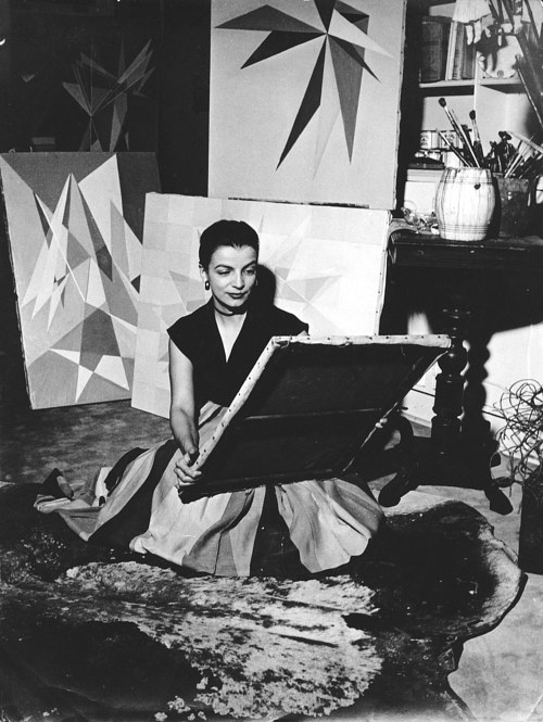 A photo of Lygia Clark working in her studio in the 1950's