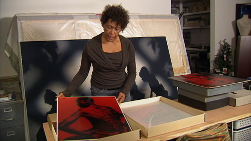 A video still of Carrie Mae Weems in her studio