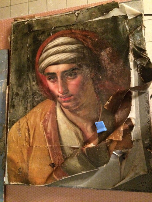 A photo of a damaged painting at the Musee Girodet