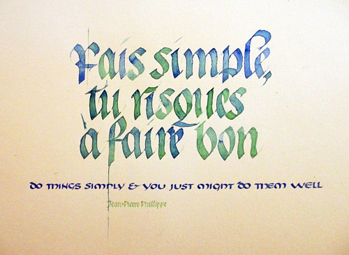 A caligraphy text artwork featuring a quote rendered in blue and green text