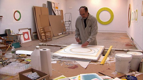 A photo of minimalist artist Robert Mangold at work in his studio