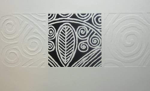 An embossed print of an abstract pattern