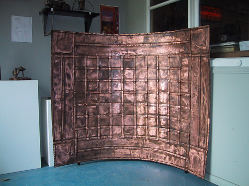 A photo of a custom copper screen in a home