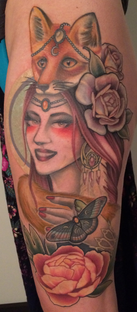 A tattoo with  a woman wearing a fox's head