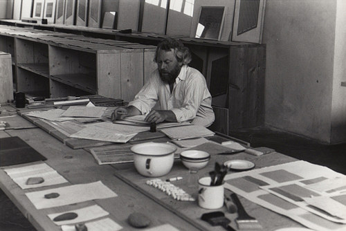 A photo of Donald Judd working on woodcuts in his studio