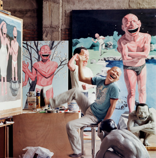 A photo of Yue Minjun in his art studio