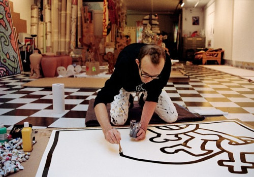 A photo of Keith Haring in his studio