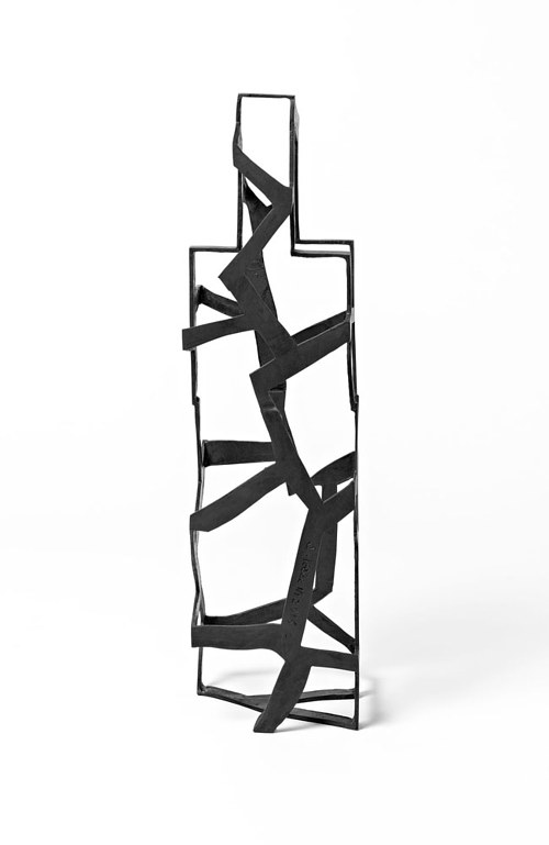 An abstract sculpture with the form of an odd building