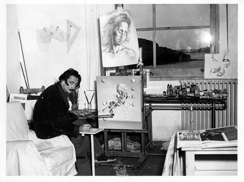 A photograph of Salvador Dali in his studio in the 1950s