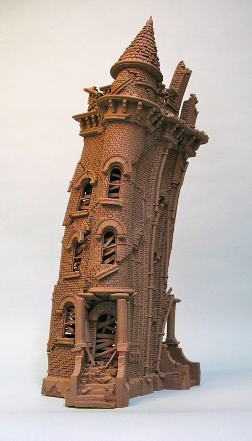 A sculpture of a brownstone building