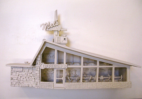 A wall-hanging sculpture of a mid-century cafe