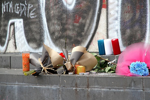 A photo of memorial items left after the 2015 Paris bombings