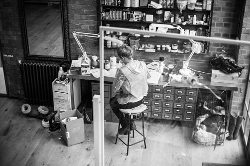 A photo of Polly Morgan at work in her studio