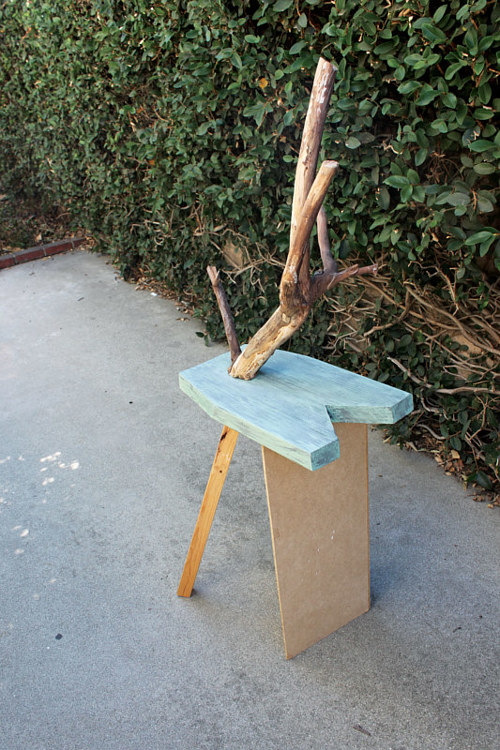 A furniture object made from wood in varying states