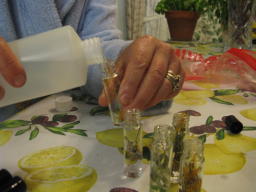 A photo of a woman making cologne from flowers