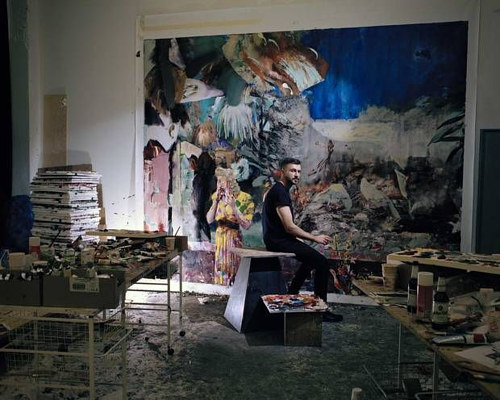 A photograph of Adrian Ghenie at work in his studio